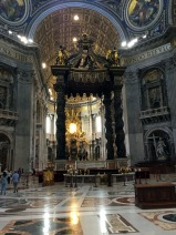 Bernini's Baldacchino, a pavilion-like structure almost 100 feet tall and claimed to be the largest piece of bronze in the world, which stands beneath the dome and above the altar